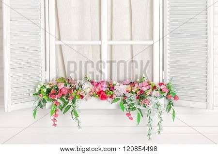 Blooming Flower Bed Under The Window.  Windowsill With Flowers