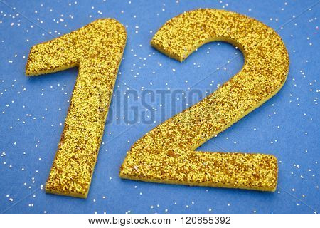 Number Twelve Yellow Color Over A Blue Background. Anniversary