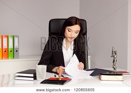 Brunette Woman Notary Public Reading And Signing Testament