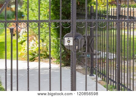 wrought iron fence covered in summer outdoors