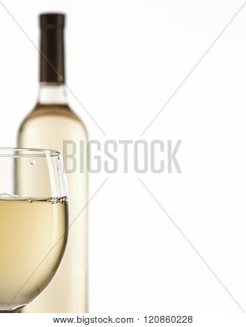 Wineglass and bottle with white wine isolated on white background. Copy space.