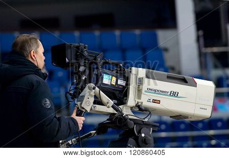 MOSCOW - JANUARY 29 2016: Unidentified director filming hockey game Sweden vs Czech on League of World legends of Ice hockey championship in VTB ice arena Russia. Czech won 8:2