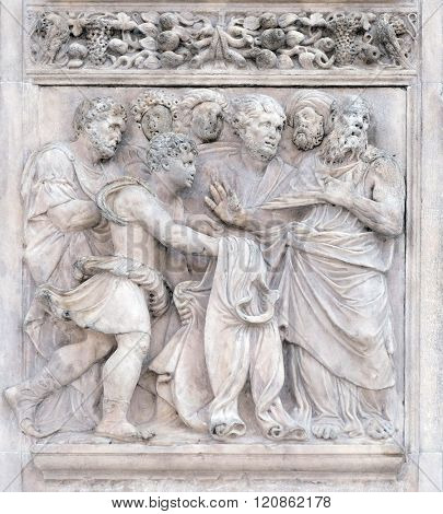 BOLOGNA, ITALY - JUNE 04: The brothers show Joseph's clothes to Jacob, panel by Girolamo da Trevisio on the right door of San Petronio Basilica in Bologna, Italy, on June 04, 2015