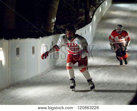 Two Sportsmen Skate Downhill