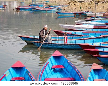 Man And Child In Boat