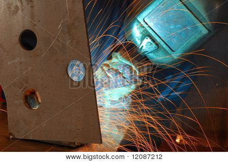 Factory welder doing his hard job