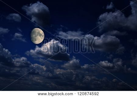 Moon Over Scattered Clouds