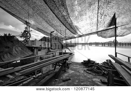 Wooden Boat Building Process At The Jetty In Black And White