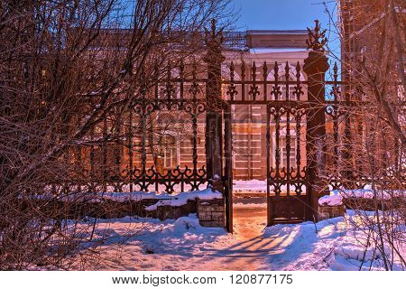 Wrought iron gate in winter scene, HDR