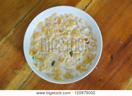 cornflakes and milk in white circle bowl