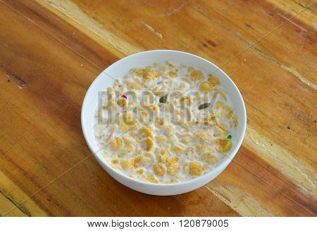 cornflakes and milk in circle bowl