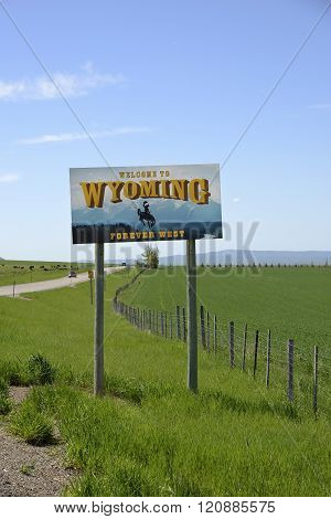 Wyoming, USA - June 02, 2015: Welcome to Wyoming sign that greets visitors as they enter the state. It is erected and maintained by the Wyoming Department of Transportation.