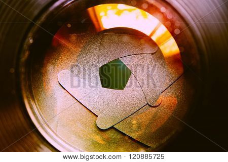 The Diaphragm Of Lens Aperture With Flare. Selective Focus With Shallow Depth Of Field. Vintage Filt