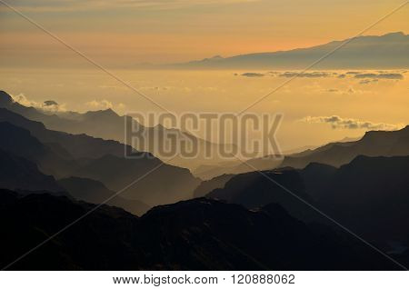 Silhouettes of mountains at sunset