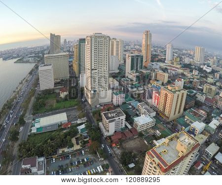 Manila, Philippines - January 19, 2015: Roxas Boulevard at evening, high-rise buildings skyscrapers in Manila, Philippines .