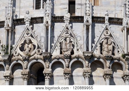 PISA, ITALY - JUNE 06: Virgin Mary with baby Jesus, St. John and St. Mark the Evangelist, Baptistery decoration architrave arches, Cathedral in Pisa, Italy. Unesco World Heritage Site, on June 06,2015