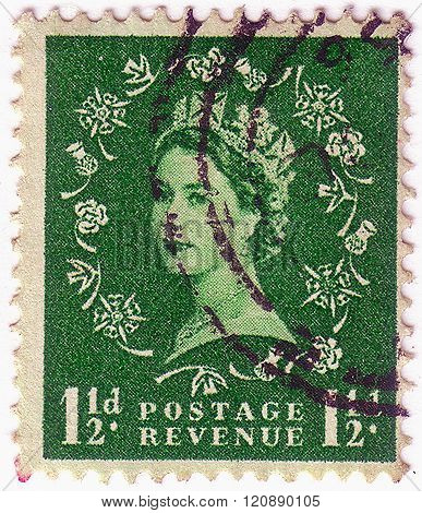 United Kingdom - Circa 1952 To 1965: An English One And Half Pence Green Used Postage Stamp Showing