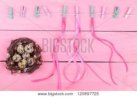 Nest With Eggs And Tapes On A Pink Background.