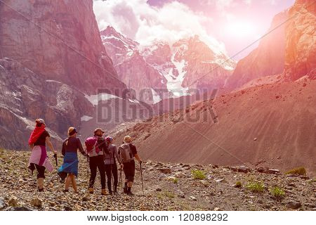 Group of Hikers Walking into Wilderness