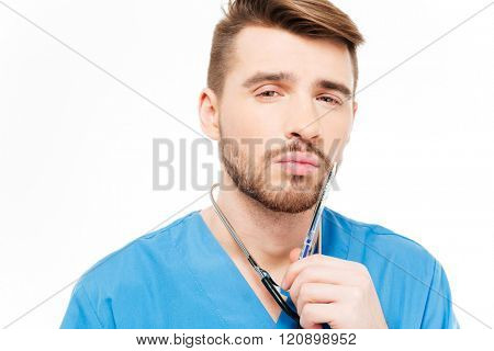 Pensive male doctor standing isolated on a white background