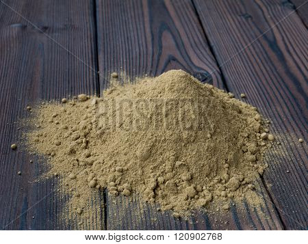Henna Powder Pile On The Textured Wooden Background