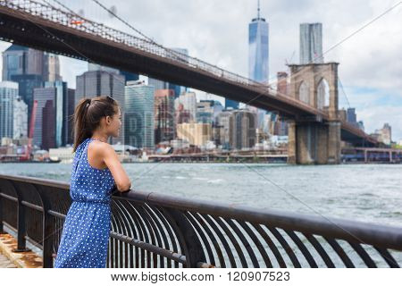 New York city urban woman enjoying view of Brooklyn bridge and NYC skyline living a happy lifestyle