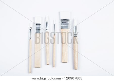White paintbrushes with wooden handle
