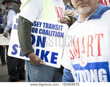 MAR 5, 2016 - WOODBRIDGE, NJ: NJ Transit rail workers wearing tshirts with the slogan SMART and Strong hold strike signs to support the rail labor unions rally one week before the strike deadline.