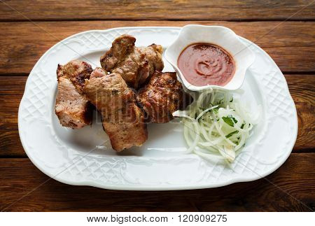 Restaurant food. Hot meat dish. Barbecue grill