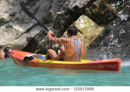 Young Man Kayaking In The River