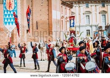 Flag-wavers Of The Districts And  Drummer In Medieval Parade