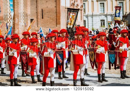 Asti, Italy - September 16, 2012: Asti, Italy - September 16, 2012: the historical Medieval parade of the Palio of Asti in Piedmont, Italy. Drummer and trumpeters in medieval parade and flag-wavers of the districts
