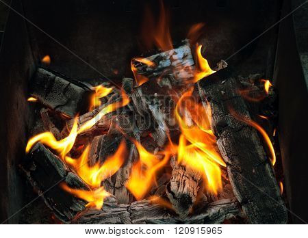 Fire. Hot coals in the grill. Burning wood in a brazier. closeup of live coals in the hot stove