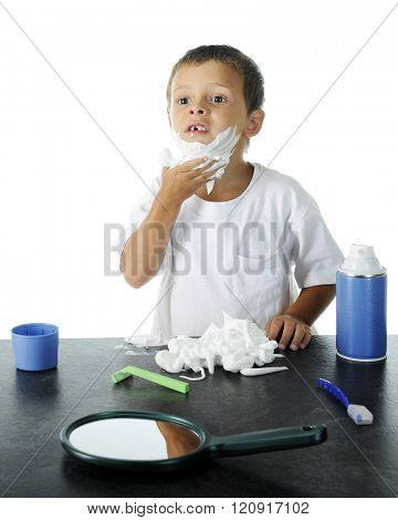 An adorable preschooler (missing a tooth) attempting to shave like his dad.  On a white background.
