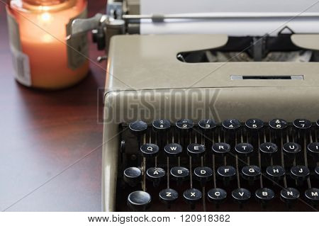 Old Typewriter And Paper On A Table