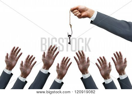 hand of a businessman holding a fish hook with a key over many hands of businessmen - opportunist concept