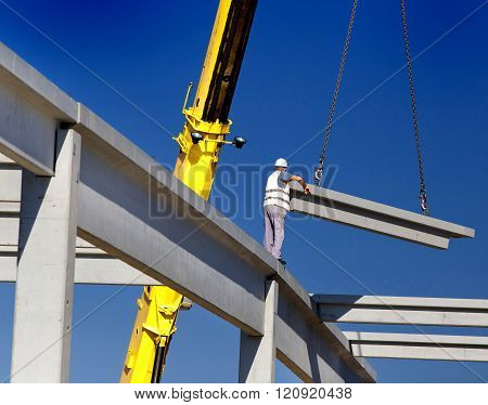 Height Worker Placing Truss On Building Skeleton