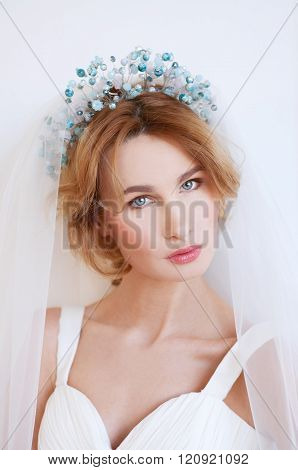 Something Blue. Blond Bride With Beaded Headpiece.
