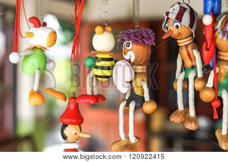 colorful wooden crrtoon dolls hung on coil