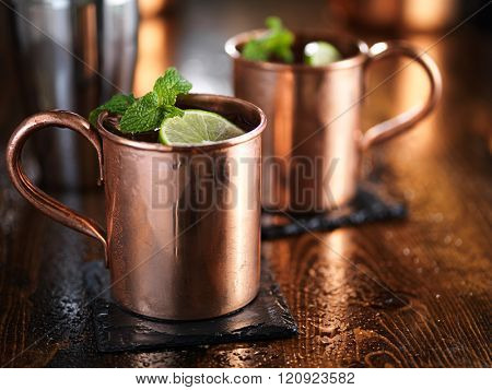 moscow mules in copper cups with mint and limes