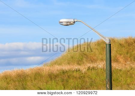 A Street Light Pole With Beautiful Nature Scene Background.