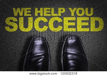 Top View of Business Shoes on the floor with the text: We Help You Succeed