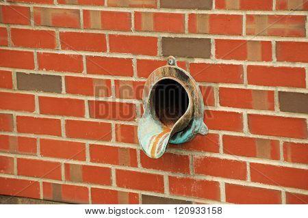 rain drainage on brick wall