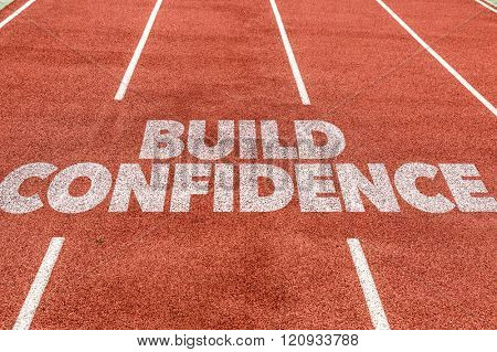 Build Confidence written on running track