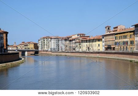 PISA, ITALY - JUNE 06, 2015: River Arno floating through the medieval city of Pisa in Italy, on June 06, 2015