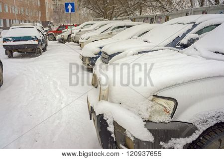 Parking Lot With Cars Covered By Snow
