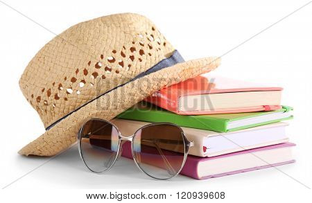 Travel set: books, hat and glasses, isolated on white