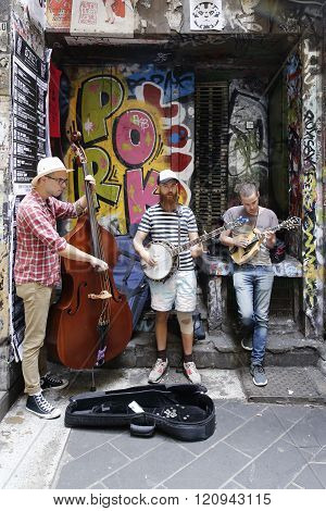 Street musicians performing in Melbourne, Australia.