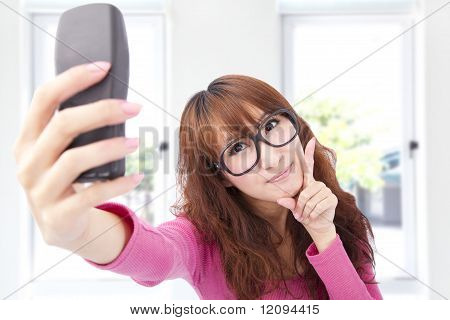 Young asian woman take photo by her cell phone