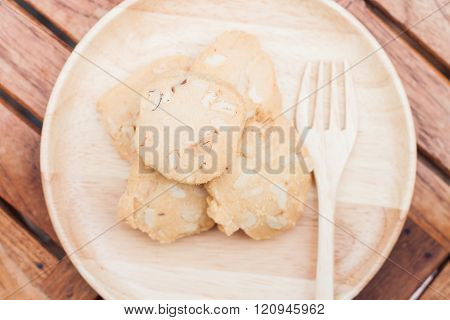 Cashew cookies on wooden plate